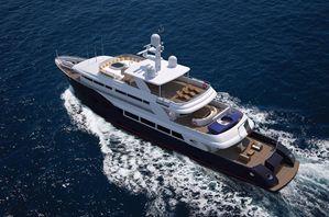 Advanced motor yacht cutting into head seas.